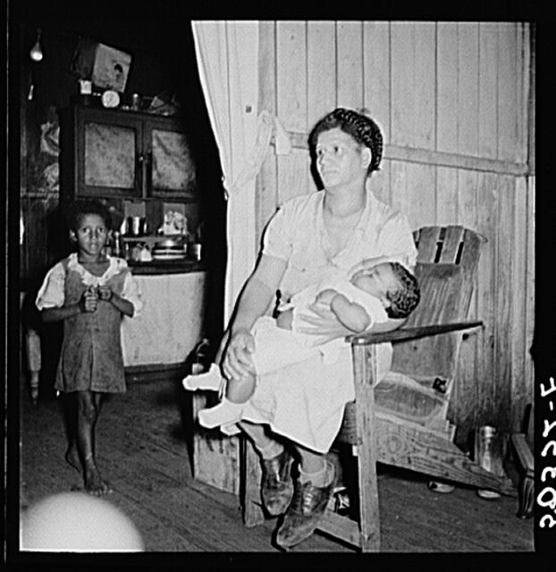 """Coal miner's wife (note goiter) and two children. Chaplin, West Virginia"" (1938) Photo by Marion Post Wolcott for the U.S. Farm Security Administration.  From the Library of Congress Prints and Photographs Division."