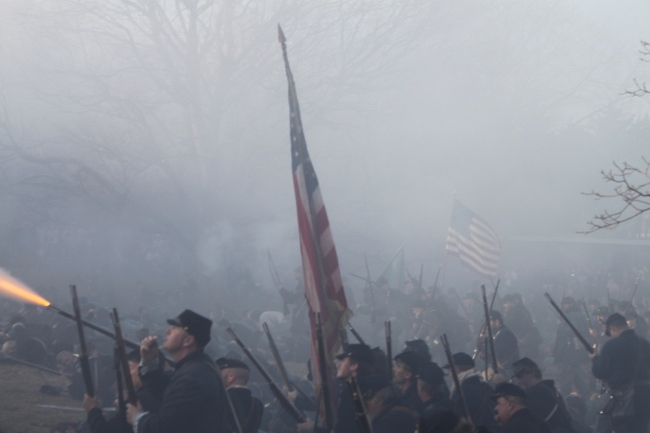 Flags, fire and smoke at the Battle of Fredericksburg reenactment.