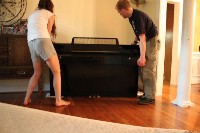 Piano movers 'r us.  Fortunately, all we had to do was slide it a little down the hall.