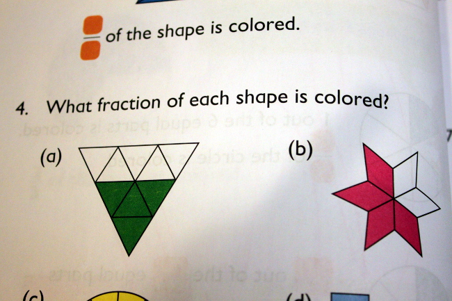 Singapore Math's mind-stretching fraction exercises for second grade.