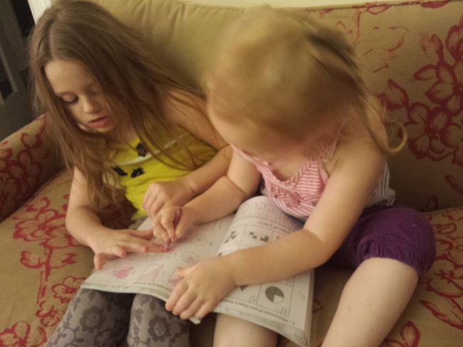 homeschooling sisters teaching each other fractions