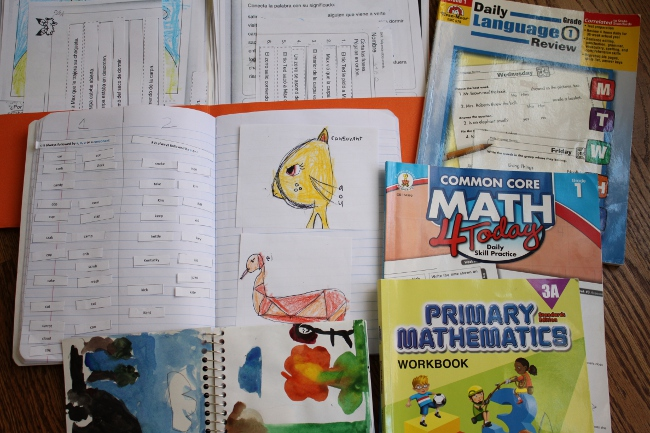 Homeschool record keeping - a collection of notebooks and workbooks.