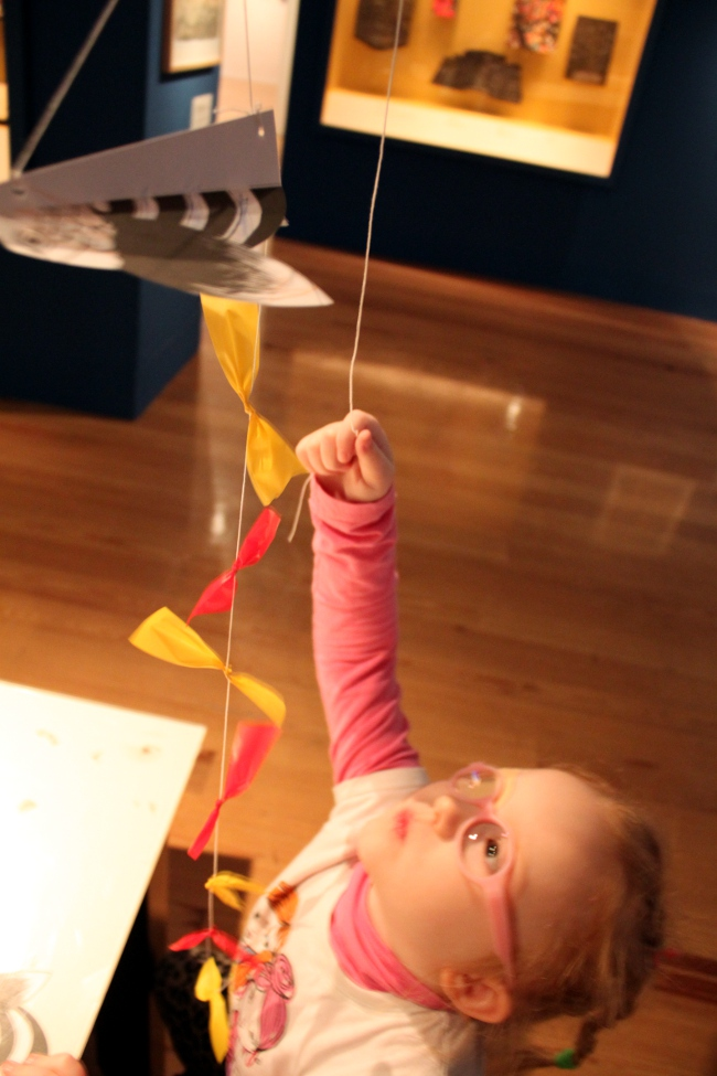 Admiring the finished kite craft.