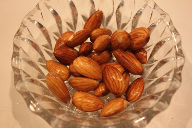 Midnight snack of soaked almonds.