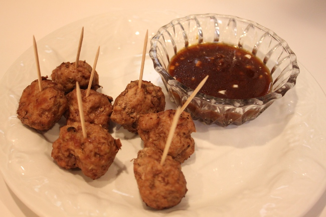 """I asked my husband what he wanted for dinner and he responded, """"MEAT!""""  I made these Japanese-style meatballs from the Kids Food section of It's All Good.  I swapped ground turkey for the ground chicken the recipe called for.  These meatballs are a favorite of Gwyneth's son Moses.  The dipping sauce is """"Lee's Hoisin Sauce.""""  My husband said they were awesome but a bit dry.  This is probably the second time I have ever made meatballs before.  They are tricky to cook.  You have to make sure they are cooked all the way through but still remain juicy.  I need a little more practice."""