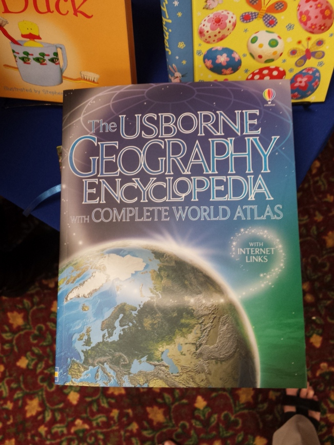 The Usborne Books booth was very popular.  These wonderful books are colorful with great pictures and layout.  I picked up this book for next year's geography lessons.