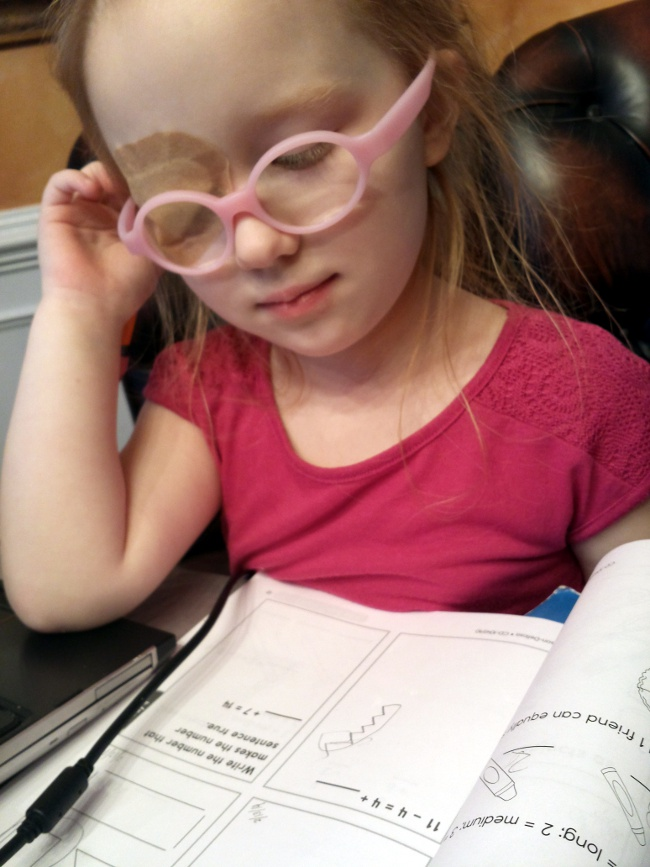 My daughter considering a problem in her Common Core workbook.