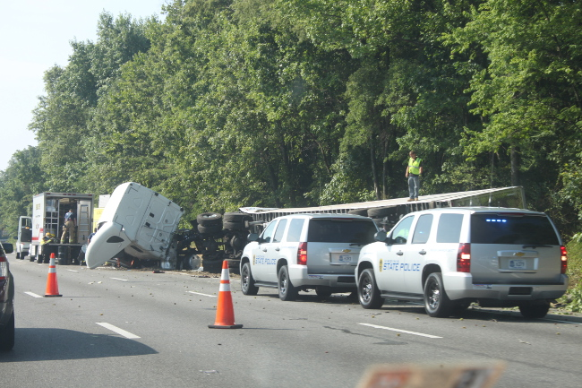 An overturned tractor trailer carrying a load of butter slowed I-95 South to a crawl.