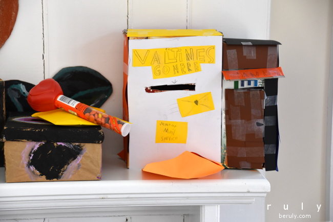 My daughter, displaying supreme organizational skills created this valentine's box with one section for cards, another door for candy and a flap on the back to open to get it all out!  I was impressed.