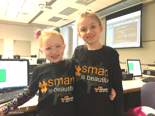 "two girls wearing ""smart is beautiful"" T-shirts"