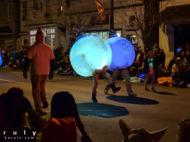 people dressed in inflatable ornament costumes, their legs exposed
