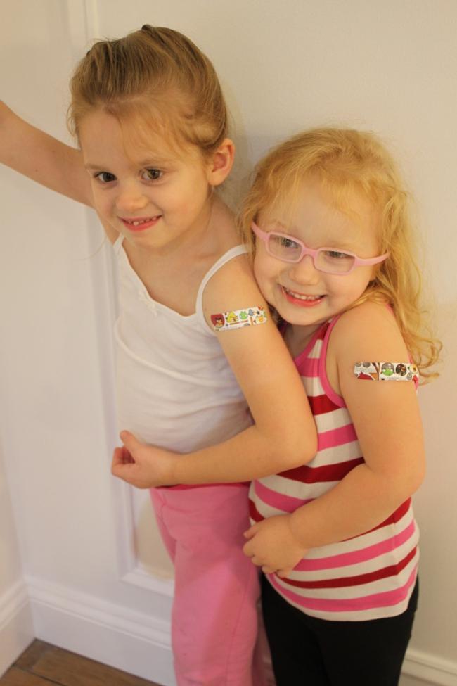 Fall's ultimate fashion accessory . . . the flu shot band-aid!