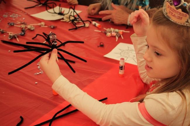 Making lollipop spiders.