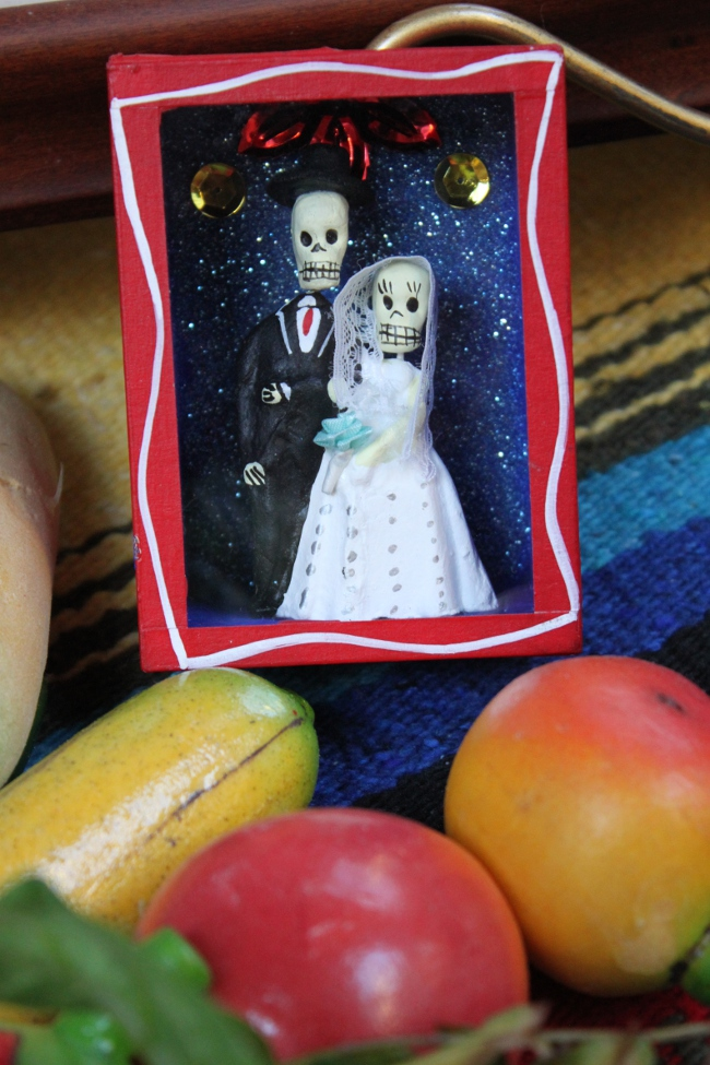 A tiny skeleton shadow box on one of the altars.