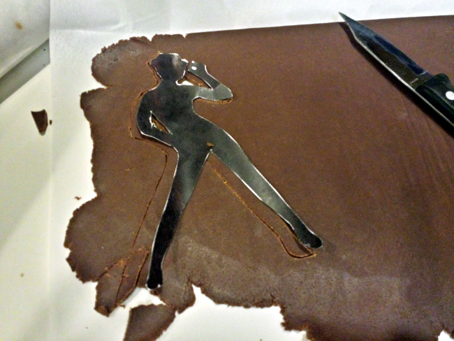 Cutting out the dancer silhouettes.