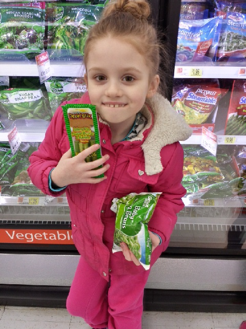 We discovered some fruit and vegetable snack packs in the produce aisle where they had combinations like peanut butter and celery, apples and caramel, carrots and hummus.  My children were interested so we purchased several of them.