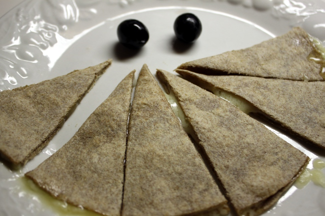 That night for dinner, the children agreed to some healthier choices like whole wheat quesadilla with olives.