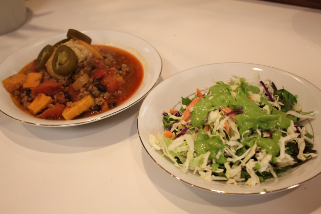 """Dinner: the imperious """"Sweet Potato and Black Bean Chili"""" and greens with parsley dressing."""