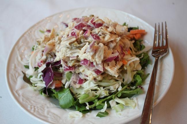 Healthy tuna salad over greens.