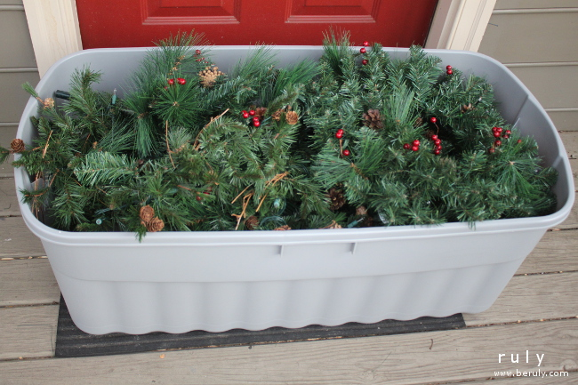Down came the front door decorations into this storage box.