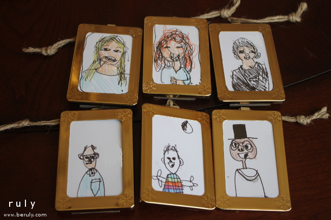 Portraits of family members done by my children.  They dressed up nicely in inexpensive $1 ornament frames.  I loved these!