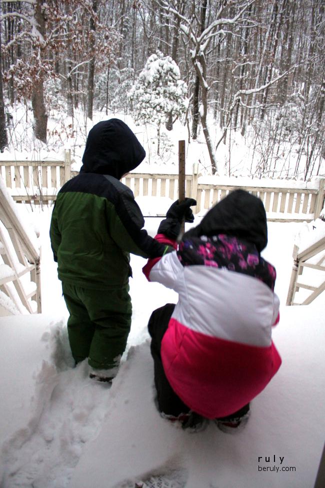 Measuring the snow.