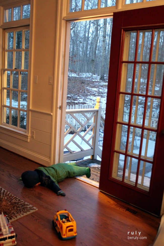 Exhaustion at the end of his snow play.  He barely made it in the door.