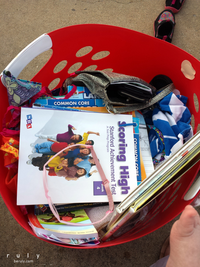 Our multitasking swim bag. Ready to homeschool while we are waiting for each child's lessons to finish.