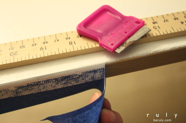 The last step....score the edge of your masking tape with a ruler and razor blade and carefully peel off the tape.  You don't want to ruin your finish right at the end!