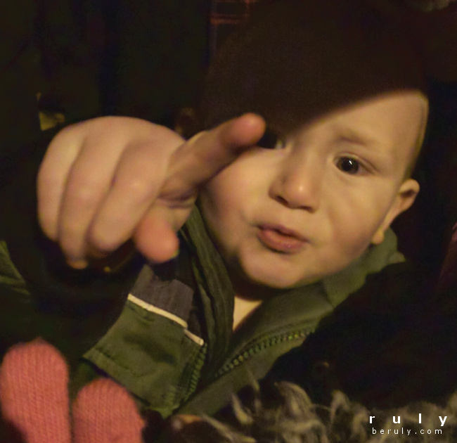 toddler pointing to Christmas parade in excitement